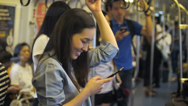 woman using phone on metro subway - public transportation stock videos & royalty-free footage