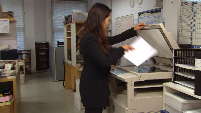 MS, Woman using photocopy machine in office