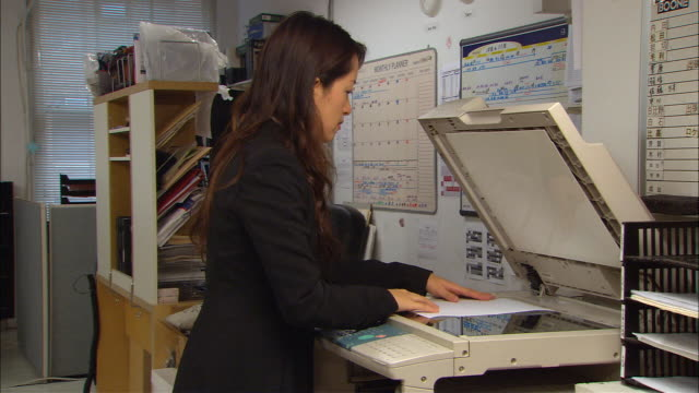 cu, woman using photocopy machine in office - only mid adult women stock videos & royalty-free footage