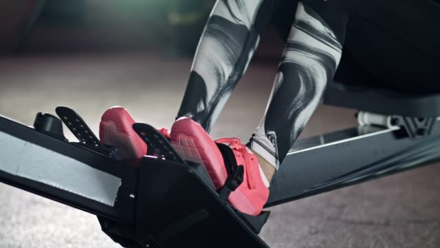 woman using rowing machine in the gym - shoes in a row stock videos & royalty-free footage