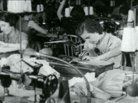 woman using sewing machine in wpa garment factory / documentary - anno 1934 video stock e b–roll