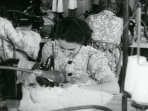 B/W 1934 woman using sewing machine in WPA garment factory / documentary