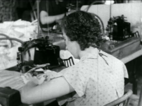 VIEW woman using sewing machine in WPA garment factory / documentary