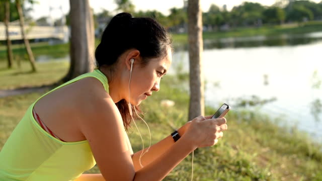 Woman using smart phone after run