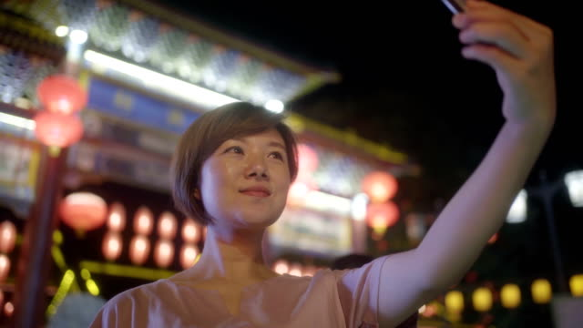 woman using smart phone at night - luck stock videos & royalty-free footage