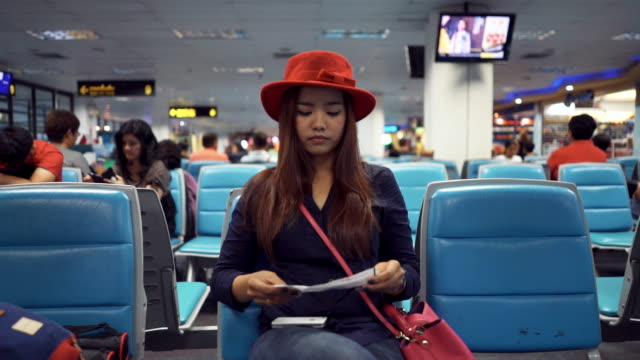 Woman using smart phone in airport