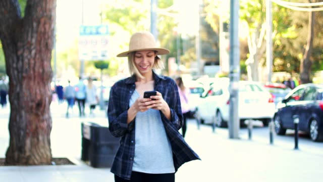 woman using smart phone in the city - letter x stock videos & royalty-free footage