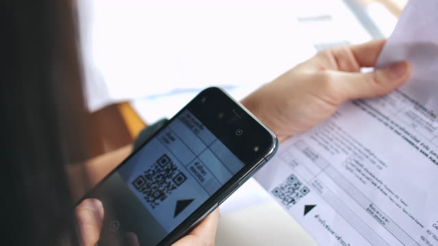 woman using smart phone scan to pay - bank statement stock videos & royalty-free footage