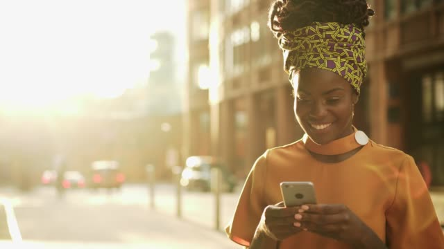 woman using smart phone, sunset, happy - headscarf stock videos & royalty-free footage