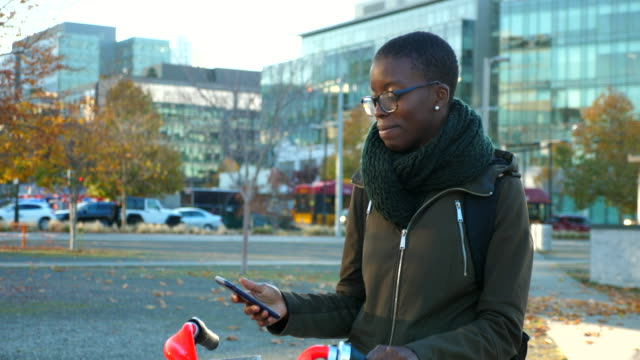 ms woman using smart phone to rent bike share - mobile phone stock videos & royalty-free footage