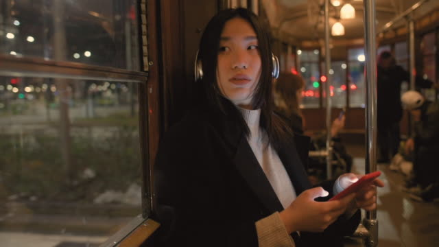 woman using smart phone - public transportation stock videos & royalty-free footage
