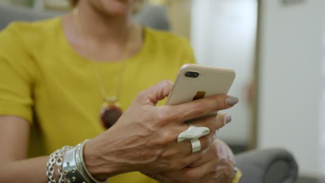 woman using smart phone - rack focus stock videos & royalty-free footage