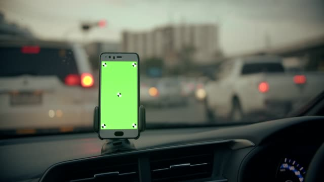 CU : Woman using smart phone with greenscreen while travel by car