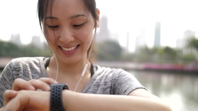 woman using smart watch for monitoring her running performance on smartwatch - interval start stock videos & royalty-free footage