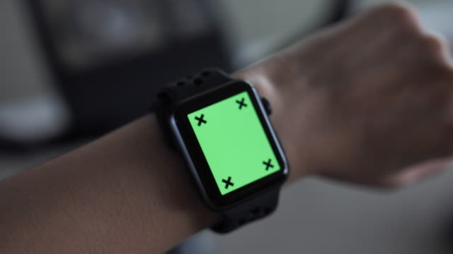 woman using smart watch with green screen while exercising - smartwatch video stock e b–roll
