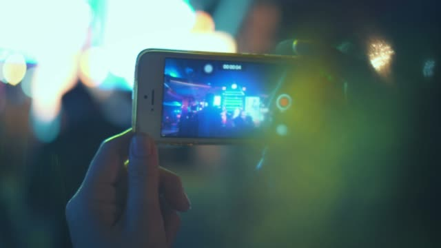 woman using smartphone at a music concert to record video of the event - theatrical performance stock videos & royalty-free footage