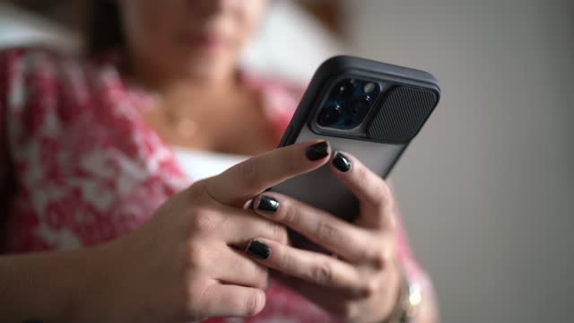 woman using smartphone at home - candid stock videos & royalty-free footage