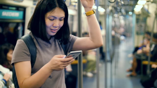 woman using smartphone in metro transportation - web browser stock videos & royalty-free footage