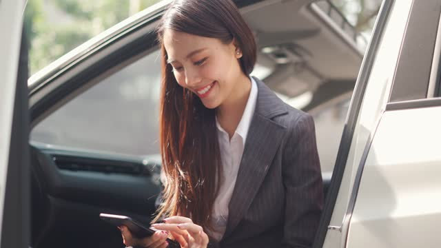 woman using smartphone in the car - car interior stock videos & royalty-free footage