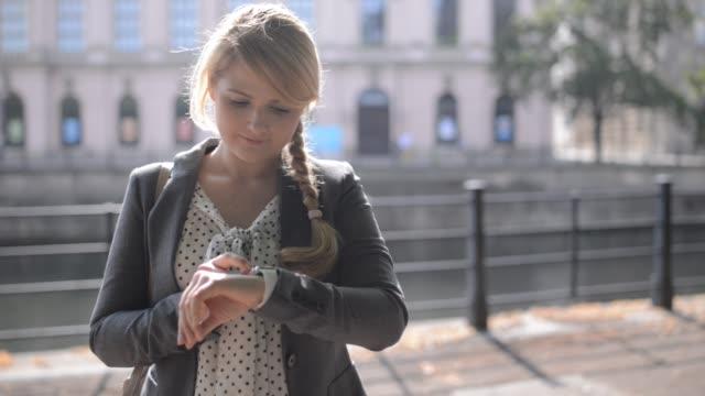 woman using smartwatch - wrist watch stock videos & royalty-free footage