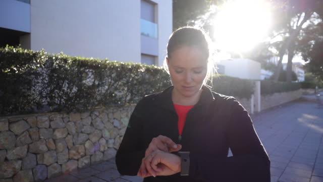 Woman using smartwatch .