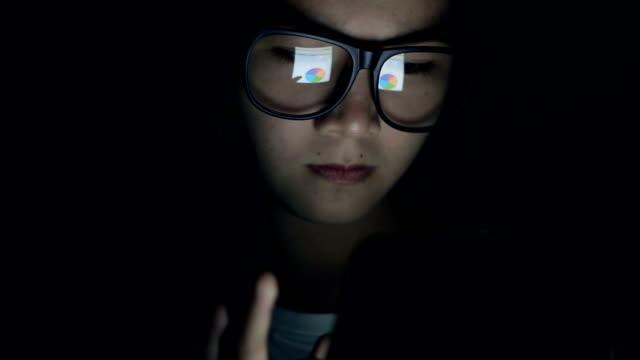 Woman using Tablet in Bedroom