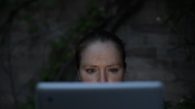 Woman Using tablet pc at Night