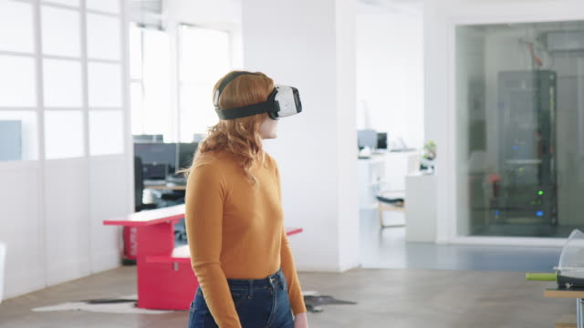 woman using virtual reality glasses in office - cyberspace stock videos & royalty-free footage