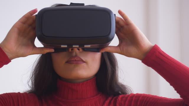 Woman using Virtual Reality headset.Slow motion.