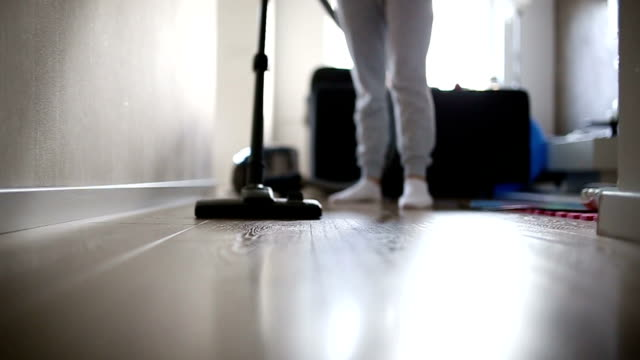 woman vacuuming her living room - vacuum cleaner stock videos & royalty-free footage