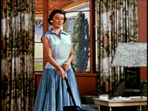 1955 woman vacuuming living room near window - stay at home mother stock videos & royalty-free footage