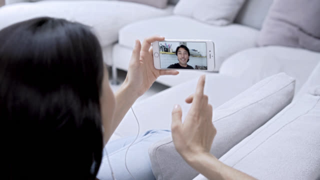 woman video chatting with her boyfriend having fun - long distance relationship stock videos & royalty-free footage