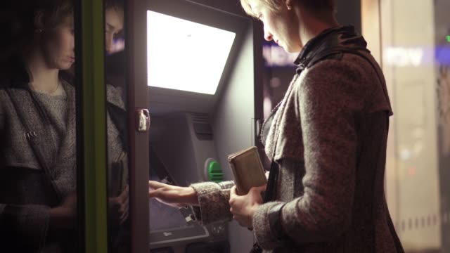 atm woman - savings stock videos and b-roll footage