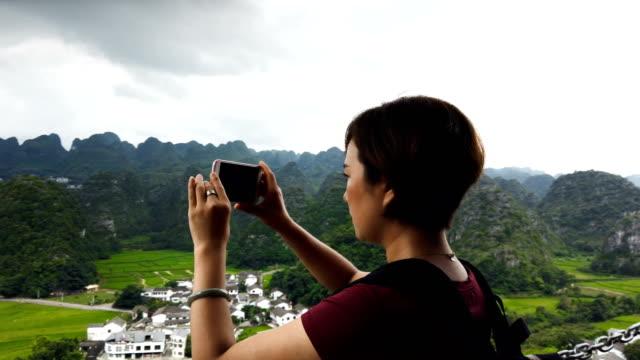 vídeos de stock e filmes b-roll de woman visit village and rice field in the karst peaks forest(wanfenglin),guizhou,china. - village