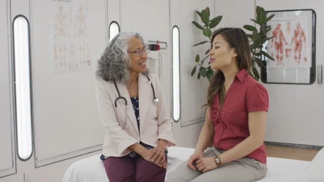 woman visiting with a doctor - hawaiian ethnicity stock videos & royalty-free footage