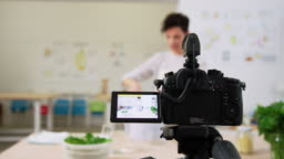 Woman vlogger recording a pasta making video