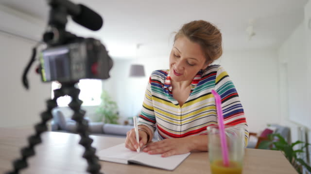 woman vlogger recording her video tutorial at home - instructions stock videos & royalty-free footage