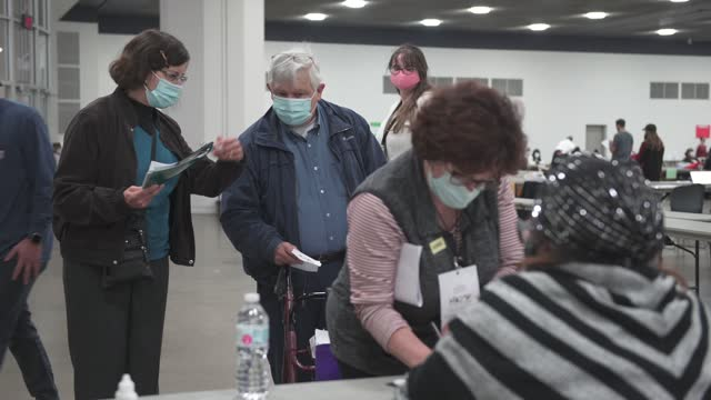 woman volunteering for the michigan republican party has her state id checked as she enters the tfc center where thousands of absentee ballots are... - north carolina us state stock videos & royalty-free footage