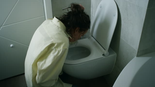 woman vomiting in bathroom - alcohol abuse stock videos & royalty-free footage