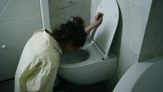 woman vomiting in bathroom - illness stock videos & royalty-free footage