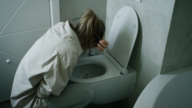 woman vomiting in bathroom - the morning after stock videos and b-roll footage