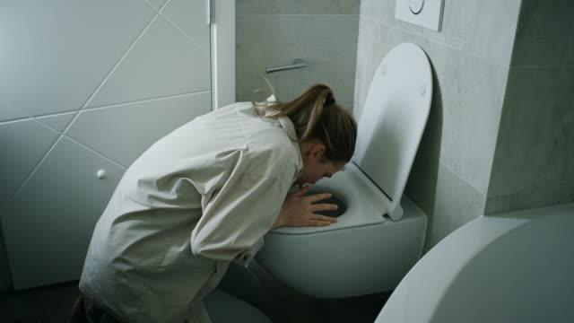 Woman Vomiting In Bathroom