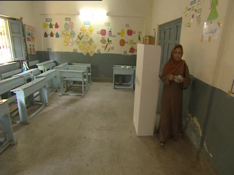 a woman votes in a polling station in karachi pakistan - karachi stock videos and b-roll footage