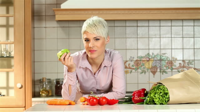 woman vs. apple - short hair stock videos and b-roll footage