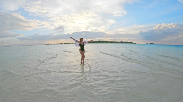 ms woman wading in tranquil tropical ocean,maldives - pointing stock videos & royalty-free footage