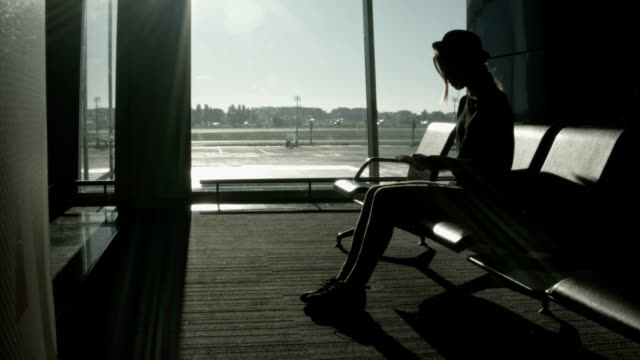 Woman waiting for departure at the airport