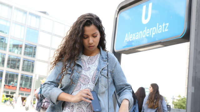 woman waiting for friends out of the subway station - alexanderplatz stock videos & royalty-free footage