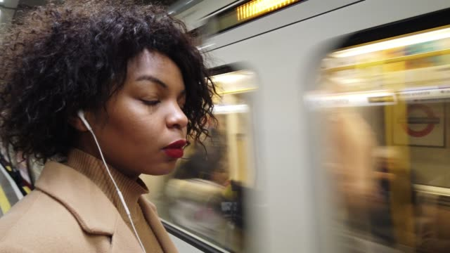woman waiting for the subway train - commuter stock videos & royalty-free footage