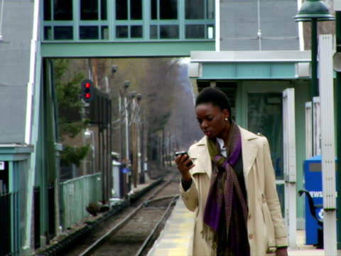 ms, woman waiting for train in station platform, using mobile phone, chappaqua, new york state, usa - one mid adult woman only stock videos & royalty-free footage