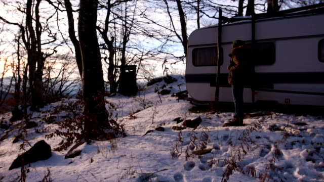 woman waiting her friend near vintage camper trailer - camper trailer stock videos and b-roll footage